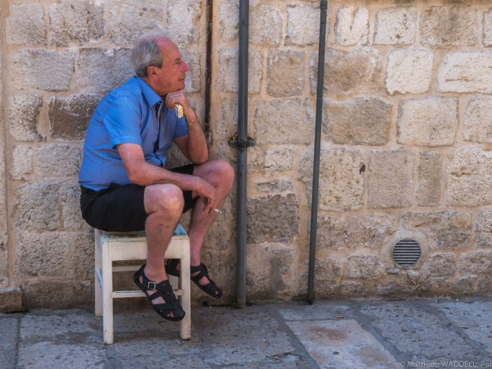 A man having a cigarette break in Dubrovnik / Croatia / Travel Photography / Street Photography / Matthieu Waddell Photo / Professional Photographer / Paris Photographer