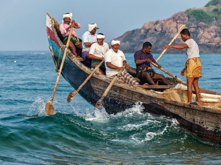 Fisherman going out to sea / Kovalam / India / Matthieu Waddell Photo