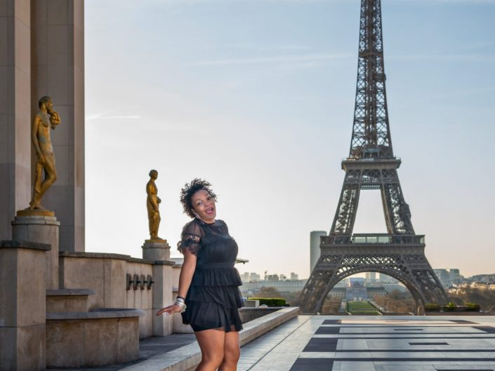 African American woman posing at the Eiffel Tower / Paris France / Travel Photography / Street Photography / Matthieu Waddell Photo / Professional Photographer / Paris Photographer